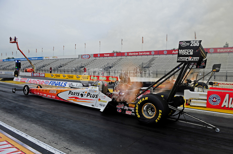 Nov. 10, 2011; Pomona, CA, USA; NHRA top fuel dragster driver Clay Millican during qualifying at the Auto Club Finals at Auto Club Raceway at Pomona. Mandatory Credit: Mark J. Rebilas-.