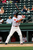 Shortstop Javier Guerra (31) of the Greenville Drive bats in a game against the Lexington Legends on Tuesday, April 14, 2015, at Fluor Field at the West End in Greenville, South Carolina. Guerra is the No. 13 prospect of the Boston Red Sox, according to Baseball America. Lexington won, 5-3. (Tom Priddy/Four Seam Images)