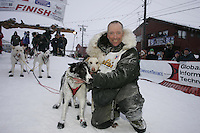 Second place finisher Ed Iten poses with his lead dogs at the finish line in Nome.    End of the  2005 Iditarod Trail Sled Dog Race.