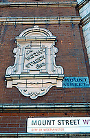London: Street Plaque on wall. Mount St. at S. Audley, Mayfair.