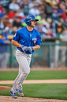 John Andreoli (7) of the Iowa Cubs walks to first base against the Salt Lake Bees in Pacific Coast League action at Smith's Ballpark on May 13, 2017 in Salt Lake City, Utah. Salt Lake defeated Iowa  5-4. (Stephen Smith/Four Seam Images)
