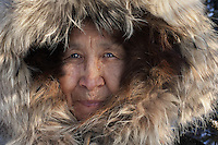 Jean Stevens, native Eskimo woman in Bettles, Arctic Circle, Alaska.<br /> I was photographing a story on the coldest places on the planet, Bettles being one of them. It was so cold my eyelashes actually froze. The northern light show was breathtaking but living here is not for the faint of heart. Jean, at 77-years-old, still runs the local post office and tears around on her snowmobile delivering the mail.