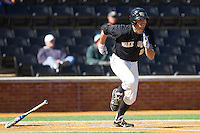 Charlie Morgan (24) of the Wake Forest Demon Deacons hustles down the first base line against the Youngstown State Penguins at Wake Forest Baseball Park on February 24, 2013 in Winston-Salem, North Carolina.  The Demon Deacons defeated the Penguins 6-5.  (Brian Westerholt/Four Seam Images)
