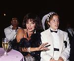 JOAN COLLINS CON LA FIGLIA KATYANA<br /> FESTA VICTOR DANENZA - VILLA ARAUCARIA- CANNES 1988