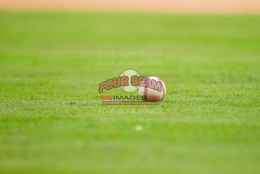 An NCAA baseball sits in the grass at Minute Maid Park on March 6, 2011 in Houston, Texas.  Photo by Brian Westerholt / Four Seam Images