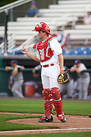 Auburn Doubledays catcher Nic Perkins (43) signals two outs during the second game of a doubleheader against the Mahoning Valley Scrappers on July 2, 2017 at Falcon Park in Auburn, New York.  Mahoning Valley defeated Auburn 3-2.  (Mike Janes/Four Seam Images)