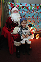 Pictured: Father Christmas meets young boy in his grotto. Thursday 15 December 2011<br /> Re: Children  have who have been treated at the burns unit of Morriston Hospital have met Swansea City FC players at the Liberty Stadium.