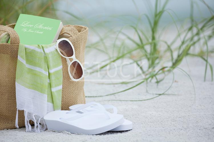 USA, Florida, St. Pete Beach, Beach bag and sandals on beach