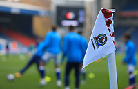 7th November 2020; Ewood Park, Blackburn, Lancashire, England; English Football League Championship Football, Blackburn Rovers versus Queens Park Rangers; Blackburn platers warm up near a corner flag decorated with Remembrance Day Poppies