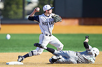 Georgetown Hoyas shortstop Ryan Busch (1) gets the force out as Cory Garrastazu (28) of the Marshall Thundering Herd slides into second base at Wake Forest Baseball Park on February 15, 2014 in Winston-Salem, North Carolina.  The Thundering Herd defeated the Hoyas 5-1.  (Brian Westerholt/Four Seam Images)