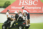 SINGAPORE - MARCH 07: Paula Creamer of the USA makes her way back to the club house during a storm break on during the third round of HSBC Women's Champions at the Tanah Merah Country Club on March 7, 2009 in Singapore. Photo by Victor Fraile / The Power of Sport Images