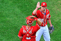 25 September 2011: Washington Nationals pitcher Drew Storen celebrates a save with catcher Wilson Ramos after a game against the Atlanta Braves at Nationals Park in Washington, DC. The Nationals shut out the Braves 3-0 to take the rubber match third game of their 3-game series - the Nationals' final home game for the 2011 season. Mandatory Credit: Ed Wolfstein Photo