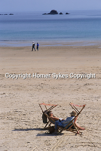 St Ouens Bay Jersey The Channel islands UK Tourists enjoying the sunshine. 2000s