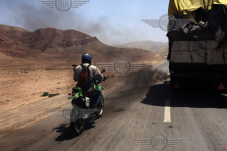 Day 2, Ash overtakes a truck spitting out a lot of pollution. What do war correspondences do on the holidays. 4 Kabul based journalists were the first westerners to ride motorcycles into the Wakhan corridor.the 12 day trip was full with dramas, breakdowns, arrests, crashes, yak riding and many miles. over 1200 kms they travelled and reached their desired destination of surhad e brogil deep in the wakhan corridor. location of the great game and once named the roof of the world.