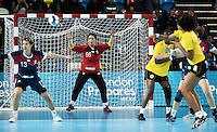 23 NOV 2011 - LONDON, GBR - Britain's goalkeeper Jane Mayes (#66, in red and black) watches as the Angolan players pass the ball back and forward in front of her goal during the 2011 London Handball Cup match at The Handball Arena in the Olympic Park in Stratford, London (PHOTO (C) NIGEL FARROW)