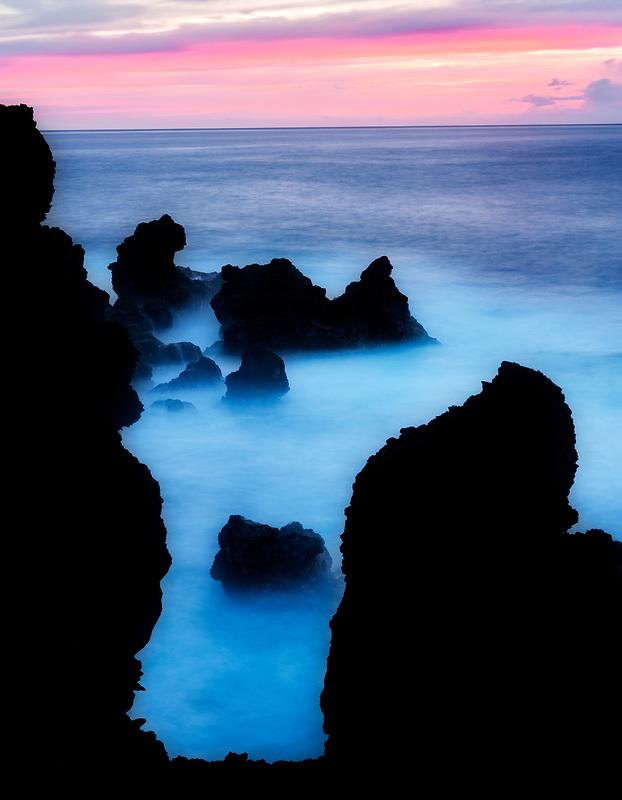 Sunrise and volcanic rocks near black sand beach. Waiananappa Trail. Maui, Hawaii