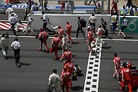The pit teams running to the Pit before the start of the race JUST BEFORE THE START F1 GRAND PRIX  SEPANG MALAYSIA MARCH 2008, FORMULA 1 WINNER IN SEPANG MALAYSIA WAS KIMMI RAIKKONEN from Finland IN HIS FERRARI FIRST PLACE, SECOND PLACE WENT TO ROBERT KUBICA from Poland IN HIS BMW-SAUBER, THIRD PLACE WENT TO HEIKKI KOVALAINEN from Finland IN A MCLAREN.