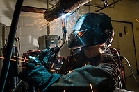 Samson Phillips practices welding during instructor Greg Russo's Welding Lab in UAA's Gordon Hartlieb Hall.