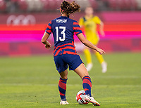 KASHIMA, JAPAN - AUGUST 5: Alex Morgan #13 of the USWNT dribbles during a game between Australia and USWNT at Kashima Soccer Stadium on August 5, 2021 in Kashima, Japan.