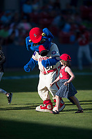 Spokane Indians mascot Otto walks off the field with a young fan during a Northwest League game against the Vancouver Canadians at Avista Stadium on September 2, 2018 in Spokane, Washington. The Spokane Indians defeated the Vancouver Canadians by a score of 3-1. (Zachary Lucy/Four Seam Images)