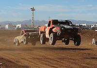 Apr 16, 2011; Surprise, AZ USA; LOORRS driver Myan Spaccarelli (12) leads Robbie Pierce (30) during round 3 at Speedworld Off Road Park. Mandatory Credit: Mark J. Rebilas-
