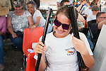 Madison Hood, 14, from the Sierra Valley Trap Club, laughs while holding two guns during the California Youth Shotgun Shooting Association's championship shootout at the Capitol City Gun Club in Carson City, Nev. on Saturday, May 2, 2015.<br /> Photo by Kevin Clifford/Nevada Photo Source