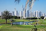 United Arab Emirates, Dubai: Emirates Hills, The Montgomerie Golf Club and skyline of Dubai Marina area