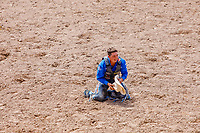 USA , Wyoming, Cheyenne Spencer Wright, Milford,UT,  at the end of his perfomance at the  saddle bronc section  at 2017 Cheyenne Frontyer days