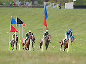 Flag, you're it. The Gwathmey field, led by Sermon of Love, passes in front of the cones and flags early in the Gwathmey.