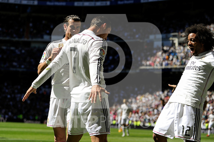 Real Madrid´s Cristiano Ronaldo and Marcelo Vieira celebrates a goal during 2014-15 La Liga match between Real Madrid and Granada at Santiago Bernabeu stadium in Madrid, Spain. April 05, 2015. (ALTERPHOTOS/Luis Fernandez)