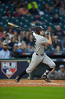 Connor Kaiser (12) of the Vanderbilt Commodores follows through on his swing against the Louisiana Ragin' Cajuns in game five of the 2018 Shriners Hospitals for Children College Classic at Minute Maid Park on March 3, 2018 in Houston, Texas.  The Ragin' Cajuns defeated the Commodores 3-0.  (Brian Westerholt/Four Seam Images)