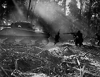 The Yanks mop up on Bougainville night at Japs would infiltrate American Lines.  At Dawn, the doughboys went out and killed them.  This photo shows tank going in its cover.  March 1944. (Army)<br /> Exact Date Shot Unknown<br /> NARA FILE #:  111-SC-189099<br /> WAR & CONFLICT BOOK #:  1185