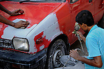 A man paints a car at his garrage in Kolkata.West Bengal, India, 2009 Arindam Mukherjee