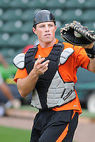 Catcher Joseph Staley (23) of the Augusta GreenJackets, a San Francisco Giants affiliate, prior to a game against the Greenville Drive on April 19, 2012, at Fluor Field at the West End in Greenville, South Carolina. (Tom Priddy/Four Seam Images).