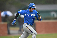 Catcher Kole Cottam (13) of the Kentucky Wildcats runs out a batted ball in a game in the rain against the University of South Carolina Upstate Spartans on Saturday, February 17, 2018, at Cleveland S. Harley Park in Spartanburg, South Carolina. Kentucky won, 6-5, in 10 innings. (Tom Priddy/Four Seam Images)