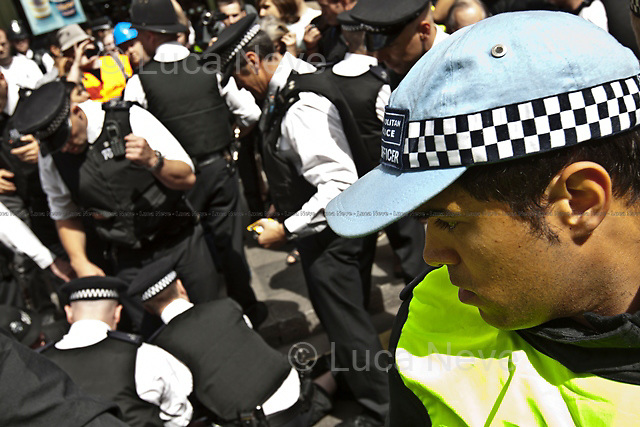 Police officer - 2011<br /> <br /> London, 30/06/2011. Today around 50,000 people marched in central London to protest against public sector cuts, the new pension reform plans, and retirement policies (the retirement age has been risen from 60 to 66 under the new coalition Government). Teachers, lecturers, and public sector workers were leading the rally organised by the National Union of Teachers (NUT), Association of Teachers and Lecturers (ATL), University and College Union (UCU) and the Public and Commercial Services Union (PCS). Several arrests were made around Whitehall and Trafalgar Square amid police action to prevent people from leaving the designed areas.