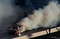 Sept. 14, 2012; Concord, NC, USA: NHRA funny car driver Jim Head does a burnout during qualifying for the O'Reilly Auto Parts Nationals at zMax Dragway. Mandatory Credit: Mark J. Rebilas-