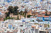 Chefchaouen, Morocco.  City View from the Trail to the Spanish Mosque.  Casbah in Center, built in 1471.