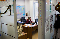 A news editor works at her desk at Komsomolskaya Pravda in Moscow, Russia.