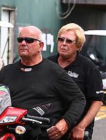 Aug. 1, 2014; Kent, WA, USA; NHRA funny car driver Gary Densham (left) and wife Joanne Densham during qualifying for the Northwest Nationals at Pacific Raceways. Mandatory Credit: Mark J. Rebilas-