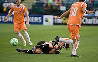 Tiffany Weimer (8) falls against Julianne Sitch (38). FC Gold Pride defeated Sky Blue FC 1-0 at Buck Shaw Stadium in Santa Clara, California on May 3, 2009.