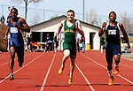 SPEARFISH, SD -- April 04, 2008: Clayton Kuhfeld of Black Hills State barrels down the track between Thomas Whyley and Lavardo Sands of Dickinson State during the men's 100-meter dash during the Black Hills State University Frostbite Invitational college track and field meet Friday, April 4, 2008 at Lyle Hare Stadium in Spearfish. (Photo by Jeff Easton/Inertia)