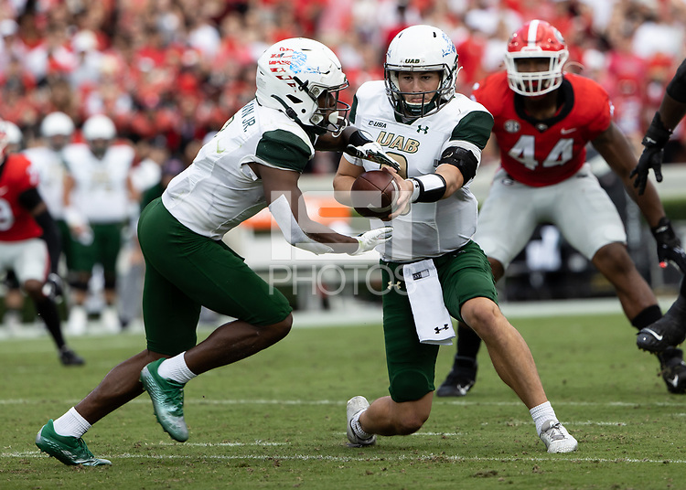 ATHENS, GA - SEPTEMBER 11: Dylan Hopkins #9 of the UAB Blazers hands the ball of to Jermaine Brown Jr. #1 during a game between University of Alabama Birmingham Blazers and University of Georgia Bulldogs at Sanford Stadium on September 11, 2021 in Athens, Georgia.