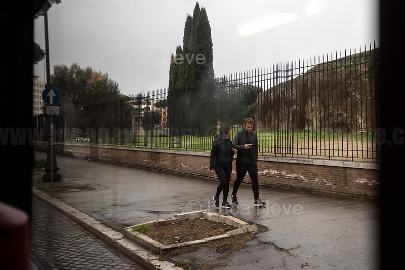 Rome, Italy. 17th Mar, 2021. Documenting Rome from a Bus window (Number 81) and during a quick walk in the City center, while the new and tougher Covid-19 restrictions, imposed by Mario Draghi's Government, have been implemented since Monday morning in Rome, its surrounding Lazio Region, and other 9 Regions, including: Lombardia, Campania, Molise, Emilia Romagna, Friuli-Venezia Giulia, Marche, Piemonte, Puglia, Veneto and Autonomous Province of Trento. The local authorities tightened rules and restrictions due to a spike in the Covid-19 / Coronavirus cases. A new self-certification (autocertificazione, downloadable from here 1.) is needed to leave home which is allowed only for urgent reasons, mainly work and health. Italy will be placed under nationwide lockdown over the Easter weekend. <br />