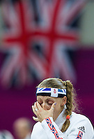 12 AUG 2012 - LONDON, GBR - Mhairi Spence (GBR) of Great Britain wipes her eyes as she waits for her next match during the women's London 2012 Olympic Games Modern Pentathlon fencing at The Copper Box in the Olympic Park, in Stratford, London, Great Britain .(PHOTO (C) 2012 NIGEL FARROW)