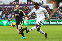 Renato Sanches of Swansea City crosses the ball into the box is marked by Harry Arter of Bournemouth during the Premier League match between Swansea City and Bournemouth at the Liberty Stadium, Swansea, Wales, UK. Saturday 25 November 2017