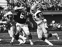 David Boone HamiltonTiger Cats is blocked by Jim Coode Ottawa Rough Riders 1976. Copyright photograph Scott Grant