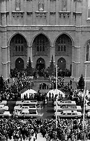 1989 FILE PHOTO - ARCHIVES -<br /> <br /> Sad procession: Massacre victims' cortege of hearses and white limousines passes by flags flown at half-staff outside Notre Dame Basilica in Montreal<br /> <br /> 1989<br /> <br /> PHOTO : Boris Spremo - Toronto Star Archives - AQP