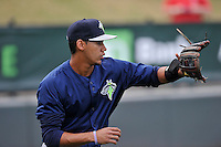Infielder J.C. Rodriguez (13) of the Columbia Fireflies warms up before a game against the Greenville Drive on Thursday, April 21, 2016, at Fluor Field at the West End in Greenville, South Carolina. Columbia won, 13-9. (Tom Priddy/Four Seam Images)