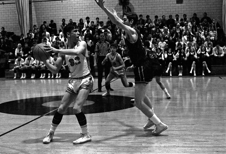 Bethel Park PA:  Scott Streiner breaking the press against the Mt Lebanon Blue Devils at Bethel Park Gymnasium.  Scott Streiner passing the ball to Steve Zemba, Mike Stewart in the background. The JV Team was coached by Mr. Reno and the Bethel Park JVs won the Section Championship.  The team included; Scott Streiner, Steve Zemba, John Klein, Mike Stewart, Bruce Evanovich, Jeff Blosel, and Tim Sullivan.